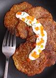 Potato pancakes with sour cream and red caviar Stock Image