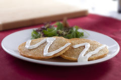 Potato Pancakes with Sour Cream and Salad Royalty Free Stock Photography