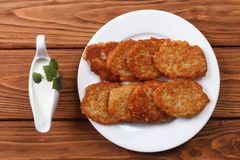Potato pancakes with sour cream sauce Royalty Free Stock Photo