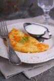 Potato pancakes with sour cream Royalty Free Stock Photos