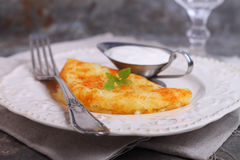 Potato pancakes with sour cream Stock Images