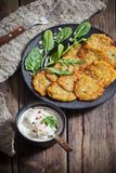 Potato pancakes with sour cream. On wooden table royalty free stock images