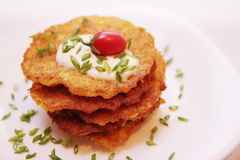 Potato pancakes with tomato Stock Photo