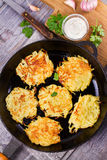 Potato Pancakes. Vegetable fritters. Latkes in frying pan. Stock Image