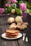 Potato pancakes. On wooden table Royalty Free Stock Photos