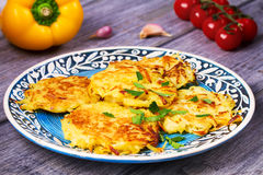 Potato Pancakes With Yogurt Sauce. Vegetable fritters. Latkes on blue plate. Stock Photo