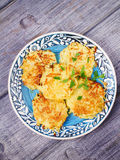 Potato Pancakes With Yogurt Sauce. Vegetable fritters. Latkes on blue plate. Royalty Free Stock Photo