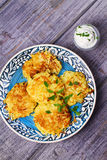 Potato Pancakes With Yogurt Sauce. Vegetable fritters. Latkes on blue plate. Stock Images