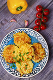 Potato Pancakes With Yogurt Sauce. Vegetable fritters. Latkes on blue plate. Royalty Free Stock Photos