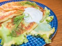 Potato pankakes with cream frache Stock Image