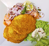 Potato pankakes with raw salmon and horseradish sauce Stock Photo