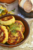 Potato patties with fried  bacon  and onions. Stock Image