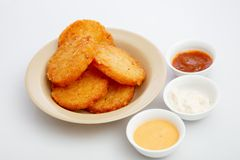 Potato patties. With dipping sauces royalty free stock photography