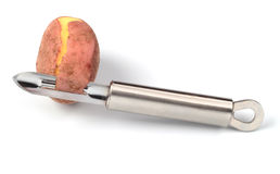 Potato and peeler Stock Image