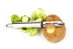 Potato with Peelerand Sprouts Stock Photos