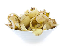Potato peelings in bowl Stock Photography