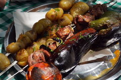 Potato pepper eggplant tomato and meat on skewers. Cooked on the grill royalty free stock photo