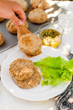 Potato and Pork Patties with Salad Leaves Royalty Free Stock Photography