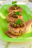 Potato and Pork Patties Topped with Marinated Gherkin Salsa Royalty Free Stock Images