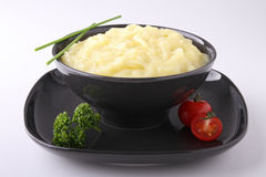 Potato puree. Bowl of potato puree and parsley Stock Photos
