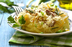 Potato puree garnished with stewed sour cabbage. Royalty Free Stock Image