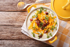 Potato puree soup with bacon and cheddar close-up in a pan. Hori Stock Photos