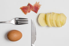 Potato, raw egg and ham Royalty Free Stock Photography