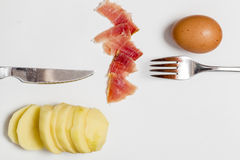 Potato, raw egg and ham Stock Photography