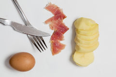Potato, raw egg and ham Stock Image