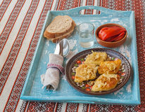 Potato rhombuses with fried onions, pickled herring and pepper o Stock Images