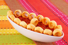 Potato rings and red sauce Royalty Free Stock Photos