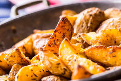 Potato. Roasted potatoes. American potatoes with salt pepper and cumin. Roasted potato wedges delicious crispy Stock Photos