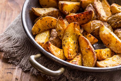 Potato. Roasted potatoes. American potatoes with salt pepper and cumin. Roasted potato wedges delicious crispy Stock Photography