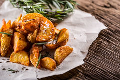 Potato. Roasted potatoes. American potatoes with salt rosemary and cumin. Roasted potato wedges delicious crispy.  Royalty Free Stock Photo