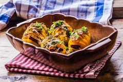 Potato.Roasts potatoes. Home cooking roasts potatoes. Baking pan full of baked potatoes stuffed with bacon sausage onions Royalty Free Stock Photos