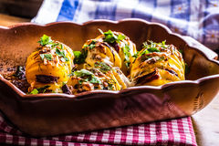 Potato.Roasts potatoes. Home cooking roasts potatoes. Baking pan full of baked potatoes stuffed with bacon sausage onions Stock Images