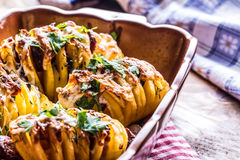 Potato.Roasts potatoes. Home cooking roasts potatoes. Baking pan full of baked potatoes stuffed with bacon sausage onions Stock Photography