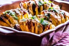 Potato.Roasts potatoes. Home cooking roasts potatoes. Baking pan full of baked potatoes stuffed with bacon sausage onions Royalty Free Stock Photo