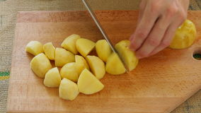 Potato root cutting; close up; stock video footage