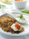Potato rosti. With smoked salmon and sour cream Royalty Free Stock Photography