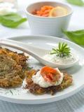 Potato rosti. With smoked salmon and sour cream Stock Photography