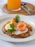 Potato rosti. With smoked salmon and sour cream Stock Photos