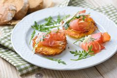 Potato rosti with bacon royalty free stock photos