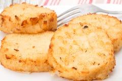 Potato Rosti cakes. Fresh potato Rosti cakes garnished with chive - studio shot Stock Photo