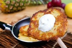 Potato rosti with herb quark. Potato pancakes with curd cheese with herbs in the pan Stock Photos
