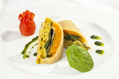 Potato roulade with spinach, carrot and curry rice Royalty Free Stock Image