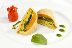 Potato roulade with spinach, carrot and curry rice Stock Photo