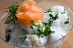 Potato salad. With smoked salmon on top stock photography
