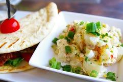 Potato salad. Gourmet potato salad and pita wrap royalty free stock photos