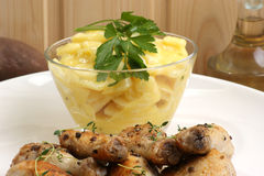 Potato salad. With some organic chicken drumsticks Royalty Free Stock Images